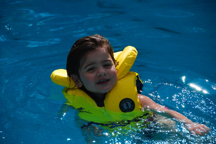 A Little Mixed-Race Girl at the Swimming Pool